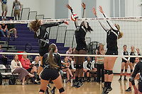 Gabby Ginapp's shot gets rejected by Round Rock Tuesday at Cedar Ridge Gym.  The Lady Raiders lost the match in four games.  (LOURDES M SHOAF for Round Rock Leader.)