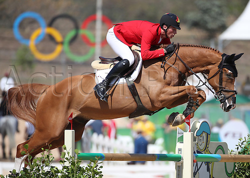 14.08.2016. Rio de Janeiro, Brazil. Daniel Deusser of Germany on horse First Class clears an obstacle during the Jumping Team 1st Qualifier of the Equestrian competition at the Olympic Equestrian Centre during the Rio 2016 Olympic Games in Rio de Janeiro, Brazil, 14 August 2016.