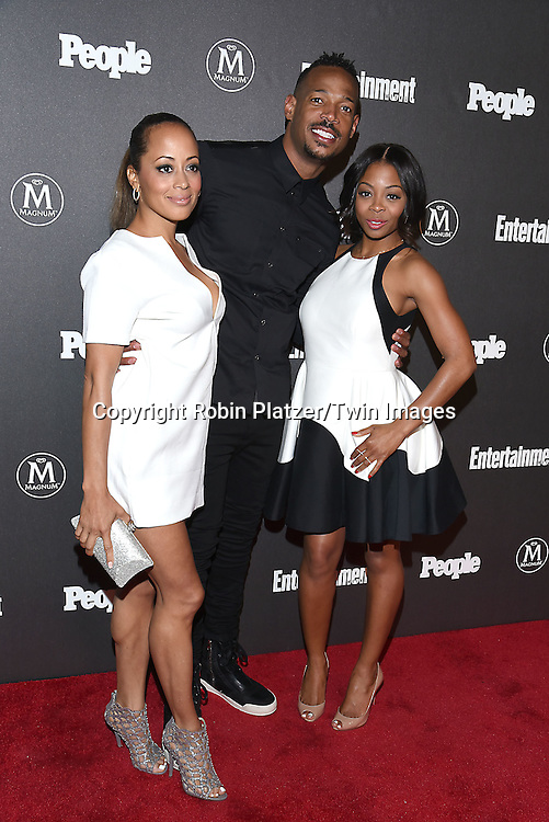 Bresha Webb, Marlon Wayans and Essence Atkins attends the Entertainment Weekly &amp; PEOPLE Magazine New York Upfronts Celebration on May 16, 2016 at Cedar Lake in New York, New York, USA.<br /> <br /> photo by Robin Platzer/Twin Images<br />  <br /> phone number 212-935-0770