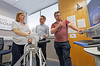 Pictured L-R: Reporter Julia Bradshaw is shown the technology by Nicholas Sleep, chief technical officer and Ben Edwards, content developer. Monday 01 July 2019<br /> Re: Intelligent Ultrasound in Cardiff, Wales, UK.