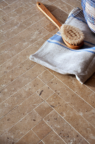 Antiquera, a handmade mosaic shown in honed Lavigne, is part of the Miraflores collection by Paul Schatz for New Ravenna.