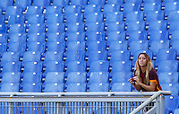 Calcio, Serie A: Roma vs Lazio. Roma, stadio Olimpico, 8 novembre 2015.<br /> A Roma fan in the Roma fans' curva Sud sector almost empty, due to a protest against security measurements, prior to the start of the Italian Serie A football match between Roma and Lazio at Rome's Olympic stadium, 8 November 2015.<br /> UPDATE IMAGES PRESS/Riccardo De Luca