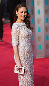 London, UK. 14 February 2016. Actress Olga Kurylenko. Red carpet arrivals for the 69th EE British Academy Film Awards, BAFTAs, at the Royal Opera House. © Vibrant Pictures/Alamy Live News