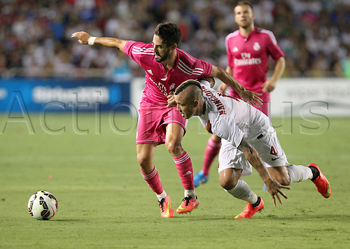 29.07.2014. Dallas, Texas, USA.  Real Madrid midfielder Isco (#23) and AS Roma midfielder Radja Nainggolan (#4) battle for the ball during the International Champions Cup match between Real Madrid and AS Roma at the Cotton Bowl in Dallas, Texas.  AS Roma won the game 1-0.