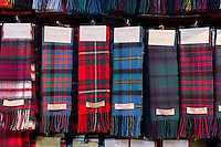 Traditional highland clan tartan scarves on display for sale at Lochcarron Weavers in Lochcarron in the Highlands of Scotland