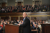 US President George W. Bush acknowledges applause before he delivers the final State of the Union address of his presidency at the US Capitol in Washington 28 January 2008.  .Credit: Tim Sloan - Pool via CNP