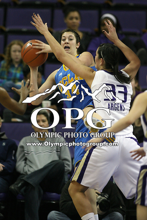 December 31, 2010:  Washington Huskies center #33 Mackenzie Argens blocks UCLA's #34 Corinne Costa from passes the ball.  UCLA defeated Washington 60-48 at Hec Ed Arena in Seattle, WA.