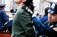 "Protesters are arrested for attempting to march across the Brooklyn Bridge as ""Occupy Wall Street"" hits its two week anniversary in New York City on October 1, 2011."