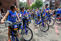 New York, NY- Ride With Pride. CitiBike riders pause for a photo at the Gay Pride Parade.