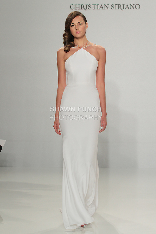 Model walks runway in a multi-strap halter gown, from the Christian Siriano for Kleinfeld bridal collection, at Kleinfeld on April 18, 2016 during New York Bridal Fashion Week Spring Summer 2017.