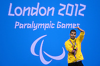 PICTURE BY ALEX BROADWAY /SWPIX.COM - 2012 London Paralympic Games - Day Nine - Swimming, Aquatic Centre, Olympic Park, London, England - 07/09/12 - Daniel Dias of Brazil poses with his Gold Medal after winning the Men's 50m Butterfly S5 Final.