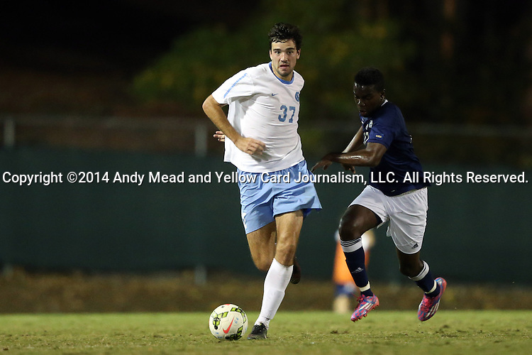 28 October 2014: North Carolina's Walker Hume (37) and Georgia Southern's Emmanuel Raji (right). The University of North Carolina Tar Heels hosted the Georgia Southern University Eagles at Fetzer Field in Chapel Hill, NC in a 2014 NCAA Division I Men's Soccer match. North Carolina won the game 6-2.