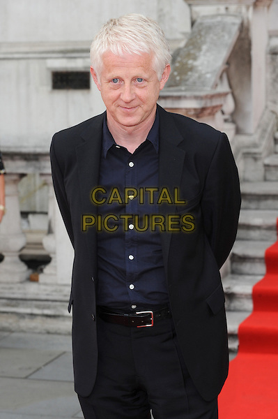 Richard Curtis<br /> attends the World Premiere of 'About Time', Somerset House, London, UK, 8th August 2013.<br /> half length arms behind back blue navy shirt suit <br /> CAP/BEL<br /> &copy;Tom Belcher/Capital Pictures