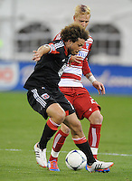 D.C. United midfielder Nick DeLeon (18) shields the ball against FC. Dallas midfielder Brek Shea (20)  D.C. United defeated FC Dallas 4-1 at RFK Stadium, Friday March 30, 2012.