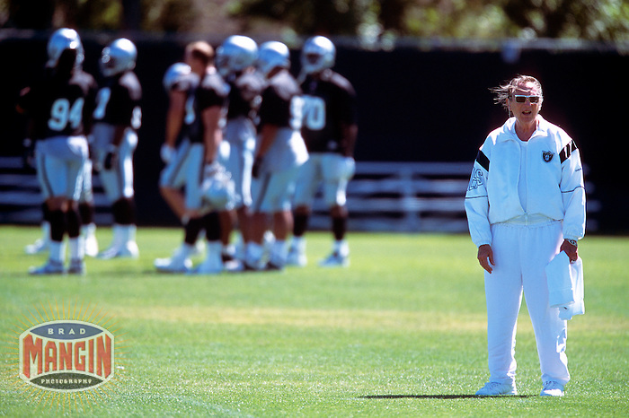 ALAMEDA, CA -  Owner Al Davis of the Oakland Raiders on the sidelines during mini camp at the Raiders practice facility in Alameda, California in 2000.  Photo by Brad Mangin