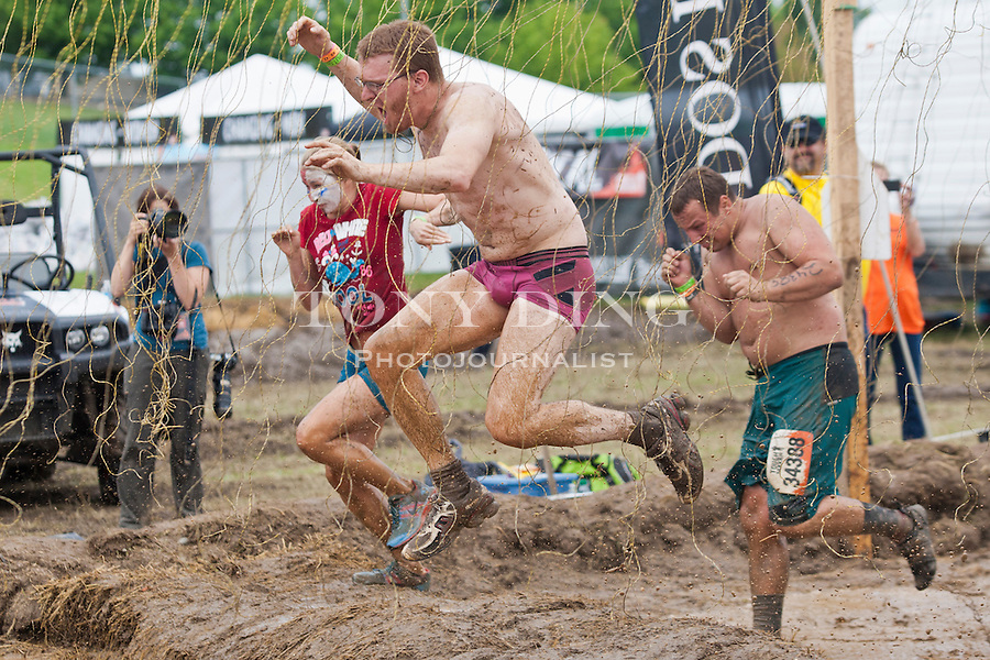 16 April 2010: Competitors fight through electric shock wires in one of twenty obstacles in the Tough Mudder adventure endurance race at Michigan International Speedway in Brooklyn, Michigan.