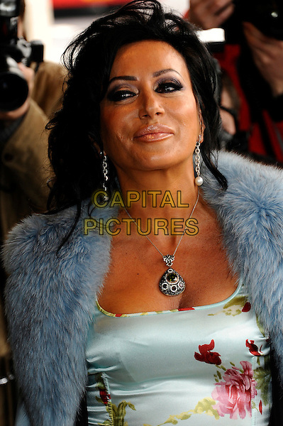 Nancy Dell'Olio.The TRIC ( TV & Radio Industries Club ) Awards, Grosvenor House Hotel, Park Lane, London, England..13th March 2012.headshot portrait blue fur jacket coat trim trim floral print pink red necklace make-up .CAP/CJ.©Chris Joseph/Capital Pictures.