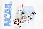 ST PAUL, MN - APRIL 7: Cale Morris #32 and Jake Evans #18 of the Notre Dame Fighting Irish clear the puck from Karson Kuhlman #20 of the Minnesota-Duluth Bulldogs during the Division I Men's Ice Hockey Championship held at the Xcel Energy Center on April 7, 2018 in St Paul, Minnesota. (Photo by Tim Nwachukwu/NCAA Photos via Getty Images)