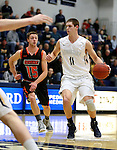 SIOUX FALLS, SD, DECEMBER 19:  Adam Beyer #11 from Augustana drives past Reid Williams #15 from Doane during their game Monday night at the Elmen Center in Sioux Falls, SD. (Photo by Dave Eggen/Inertia)