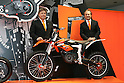 "Mar 26, 2010 - Tokyo, Japan - (L-R) Harald Plöckinger and Hubert Trunkenpolz of KTM Motorcycle AG pose with an electrically driven sports motorcycle called ""Freeride"" for offroad and supermoto riders during the 37th Tokyo Motorcycle Show at Tokyo Big Sight on March 26, 2010. This 'zero emission motorcycle' will go on sale on 2011, according to the Austrian company. (Photo Laurent Benchana/Nippon News)"