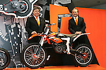 """Mar 26, 2010 - Tokyo, Japan - (L-R) Harald Plöckinger and Hubert Trunkenpolz of KTM Motorcycle AG pose with an electrically driven sports motorcycle called """"Freeride"""" for offroad and supermoto riders during the 37th Tokyo Motorcycle Show at Tokyo Big Sight on March 26, 2010. This 'zero emission motorcycle' will go on sale on 2011, according to the Austrian company. (Photo Laurent Benchana/Nippon News)"""