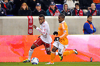 Dane Richards (19) of the New York Red Bulls is chased by Corey Ashe (26) of the Houston Dynamo. The New York Red Bulls  and the Houston Dynamo played to a 1-1 tie during a Major League Soccer (MLS) match at Red Bull Arena in Harrison, NJ, on April 02, 2011.