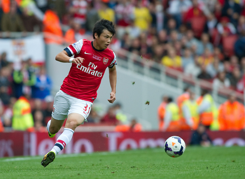 Ryo Miyaichi in action during todays match against Stoke City<br /> <br /> Photo by Ashley Western/CameraSport<br /> <br /> Football - Barclays Premiership - Arsenal v Stoke City - Sunday 22nd September 2013 - Emirates Stadium - London<br /> <br /> &copy; CameraSport - 43 Linden Ave. Countesthorpe. Leicester. England. LE8 5PG - Tel: +44 (0) 116 277 4147 - admin@camerasport.com - www.camerasport.com