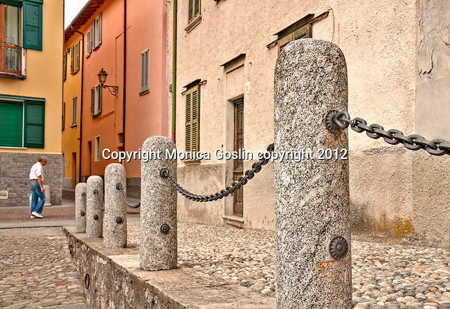 Stone posts, cobble stone streets, and colorful houses in the lake town Mandello del Lario on Lake Como, Italy
