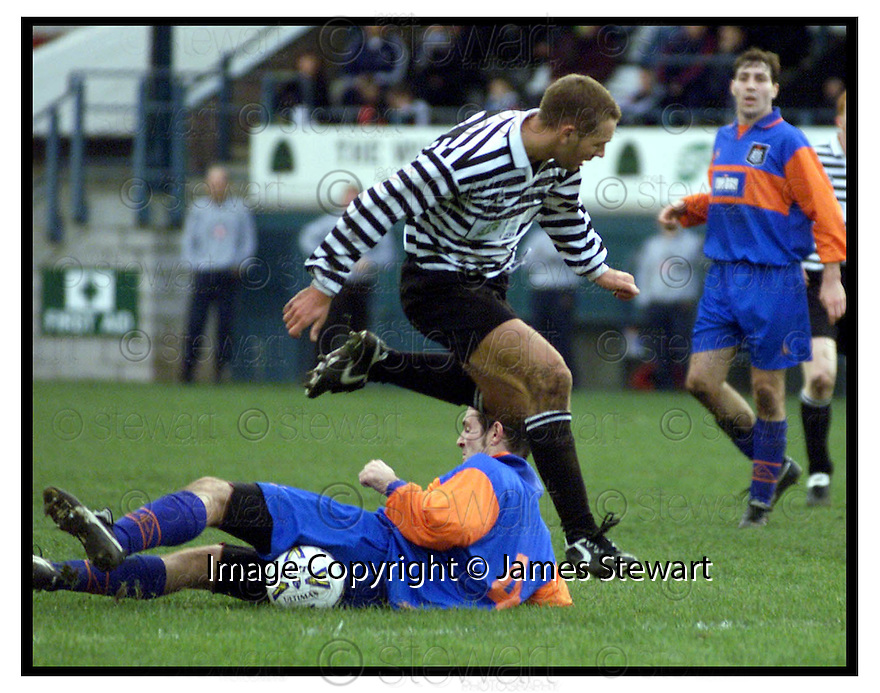 22nd Oct 99                          Copyright Pic : James Stewart .Ref :                           .File Name : stewart06-shire v queens park                        .SHIRE'S STEVEN LAIDLAW IS CHALLENGED BY QUEEN PARK'S ROSS CAVEN AT THE EDGE OF THE BOX........Payments to :-.James Stewart Photo Agency, Stewart House, Stewart Road, Falkirk. FK2 7AS      Vat Reg No. 607 6932 25.Office : +44 (0) 1324 630007        Mobile : 07721 416997.Fax     : +44 (0) 1324 630007.E-mail : jim@jspa.co.uk.If you require further information then contact Jim Stewart on any of the numbers above.........