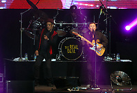 Astro and Ali Campbell of UB40 plays the guitar on stage<br /> UB40 concert at Parc Y Scarlets, Llanelli, Wales, UK. Saturday 10 June 2017
