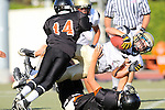 Beverly Hills, CA 09/23/11 - Andrew Phillips (Peninsula #11) and unknown Beverly Hills player(s) in action during the Peninsula-Beverly Hills frosh football game at Beverly Hills High School.