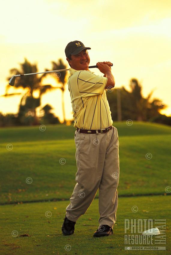 Golfer on the tee at Ko Olina Golf Club, west Oahu