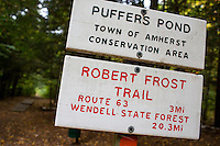 A sign indicating a portion of the Robert Frost Trail stands in Puffer's Pond Conservation Area in Amherst, Massachusetts, USA.