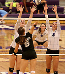 SIOUX FALLS, SD - SEPTEMBER 23: Michelle Ritland #12 and Jordan Calef #3 from University of Sioux Falls looks to block a kill attempt by Michaela Mestl #5 from Wayne State Tuesday night at the Stewart Center.  (Photo by Dave Eggen/Inertia)