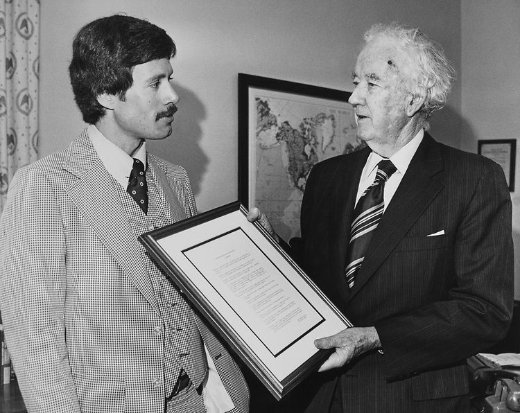 Sen. John Sparkman, D-Ala., received an appreciation plaque from the National Organization of Pi Kappa Alpha. Presening the plaque is Bill Laforge of Cleveland, Mississippi, legislative assistant to Rep. David R. Bowen. Aug. 10, 1978. (Photo by CQ Roll Call)