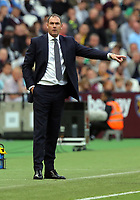 Swansea manager Paul Clement gives his players instructions during the Premier League match between West Ham United v Swansea City at the London Stadium, London, England, UK. Saturday 30 September 2017