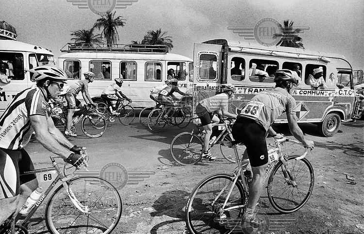 Cyclists on the first stage leaving Dakar get stuck in traffic and have to start again..The Tour du Senegal, a two-week cycle race held in average temperatures of 40 degrees Celsius, traverses the country with a total distance of 1168km.