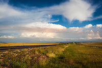 Smoke from the Owen Fire in Wyoming's Medicine Bow National Forest paints a tan band on clouds south of Laramie, Wyoming, July 7, 2014