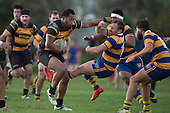 Sepu Taufa shunts Kane Hancy aside as he makes a strong run for Bombay. Counties Manukau Premier Club Rugby game between Patumahoe & Bombay, played at Patumahoe on Saturday June 18th 2016. Patumahoe won the game 27 - 15 after leading 9 - 3 at halftime. Photo by Richard Spranger.