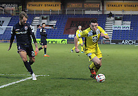 John McGinn being tracked by Martin Woods in the Ross County v St Mirren Scottish Professional Football League match played at the Global Energy Stadium, Dingwall on 17.1.15.