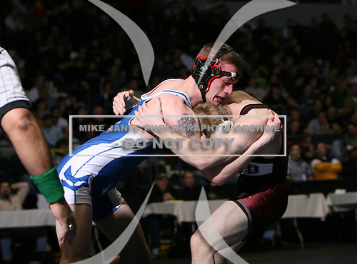 Zach Clemente (II) and Sean Floor (IX) square off in the NY State Division One finals at the 140 weight class during the NY State Wrestling Championship finals at Blue Cross Arena on March 9, 2009 in Rochester, New York.  (Copyright Mike Janes Photography)