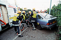 Emergency service personnel attend RTA where the driver lost control of his vehicle and hit a lamppost. They will rush the casualty on a stretcher to the awaiting HEMS helicopter that is based at the Royal London Hospital. This image may only be used to portray the subject in a positive manner..©shoutpictures.com..john@shoutpictures.com