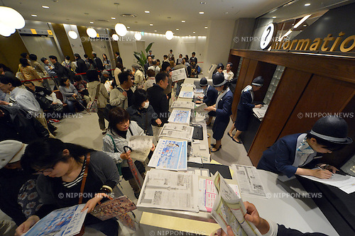 "May 22, 2012, Tokyo, Japan - Visitors get information of the Tokyo Skytree, the worlds tallest self-standing terrestrial broadcast tower at 634 meters, which opens to the public in downtown Tokyo on Tuesday, May 22, 2012...Despite the foul weather, some 8,000 visitors turned out on the first day to see the limited but 360-degree views of the nations capital from two observation decks. On the opening day alone, the operator expected about 200,000 visitors to Tokyo Skytree Town commercial complex, which consists of the tower, a 312-tenant shopping and restaurant zone called ""Tokyo Solamachi,"" an office building zone, an aquarium and a planetarium. (Photo by Natsuki Sakai/AFLO) AYF -mis-."