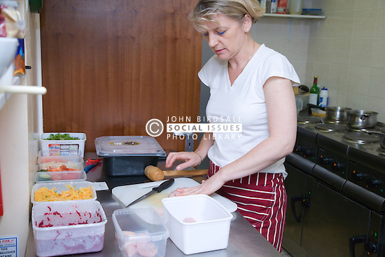 Chef preparing food in the kitchen of a Polish restaurant,