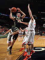 Wake Forest forward Tyler Cavanaugh (34) shoots over Virginia guard Joe Harris (12) during the game Wednesday Jan. 08, 2014 in Charlottesville, Va. Virginia defeated Wake Forest 74-51.