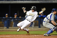Vanderbilt Commodores infielder Dansby Swanson (7) scores the game tying run during a game against the Indiana State Sycamores on February 20, 2015 at Charlotte Sports Park in Port Charlotte, Florida.  Vanderbilt defeated Indiana State 3-2.  (Mike Janes/Four Seam Images)
