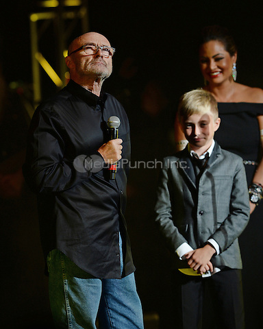 MIAMI BEACH, FL - DECEMBER 06: Phil Collins , Orianne Collins-Mejjati and their son Nicholas Collins attend the Little Dreams Foundation concert where he was scheduled to perform but decided at the last minute not to because he lost his voice leaving ticket holders wanting a refund at Fillmore Miami Beach on December 6, 2014 in Miami Beach, Florida. Credit: mpi04/MediaPunch