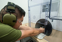 NWA Democrat-Gazette/BEN GOFF @NWABENGOFF<br /> Martin Salazar test fires a new Walther PPK pistol Friday, Jan. 4, 2019, at Walther Arms in Fort Smith.