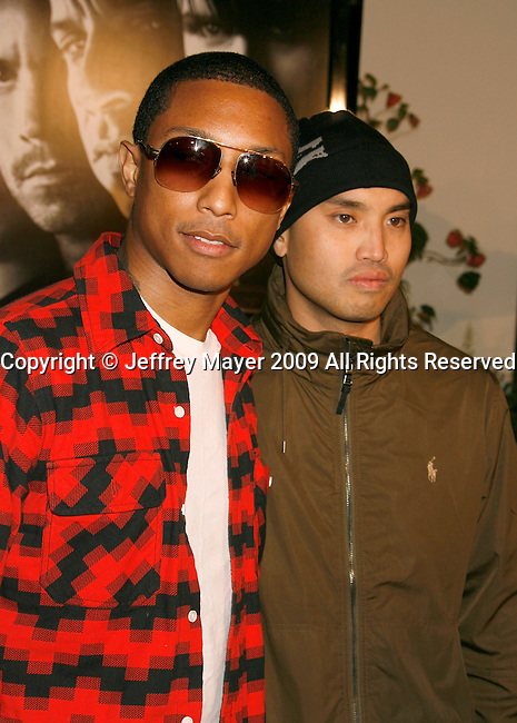 "UNIVERSAL CITY, CA. - March 12: Pharrell Williams and Chad Hugo (L-R) of N.E.R.D. arrive at the Los Angeles premiere of ""Fast & Furious"" at the Gibson Amphitheatre on March 12, 2009 in Universal City, California."