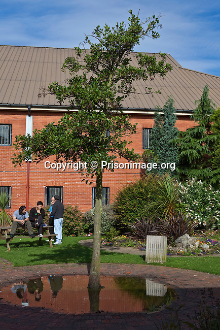 Prisoners socialising in the prison grounds. HMP The Mount, Hemel Hampstead, United Kingdom. The Mount Prison opened in 1987 as a young offenders institution, but now holds adult males.It was designed as a Category C Training prison.
